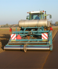 Farmer in tractor applying metam sodium soil fumigant